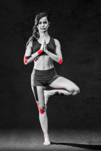 Women Doing Yoga With Kinesiology Tape On Her Joints